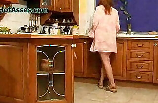 Spying Mature In The Kitchen