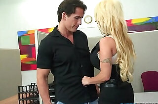 Huge titted office skank swallows load