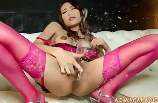 Lovely brunette whore in her pink lingerie teasing and masturbating
